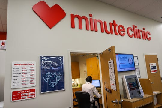 Nurse Practitioner Steven Pavloski takes a phone call from his desk at the CVS Pharmacy MinuteClinic in Clawson, Mich. on Friday, April 12, 2019. Pharmacies are expanding their health services to include services such as eyelash lengthening, dental care and teeth straightening.