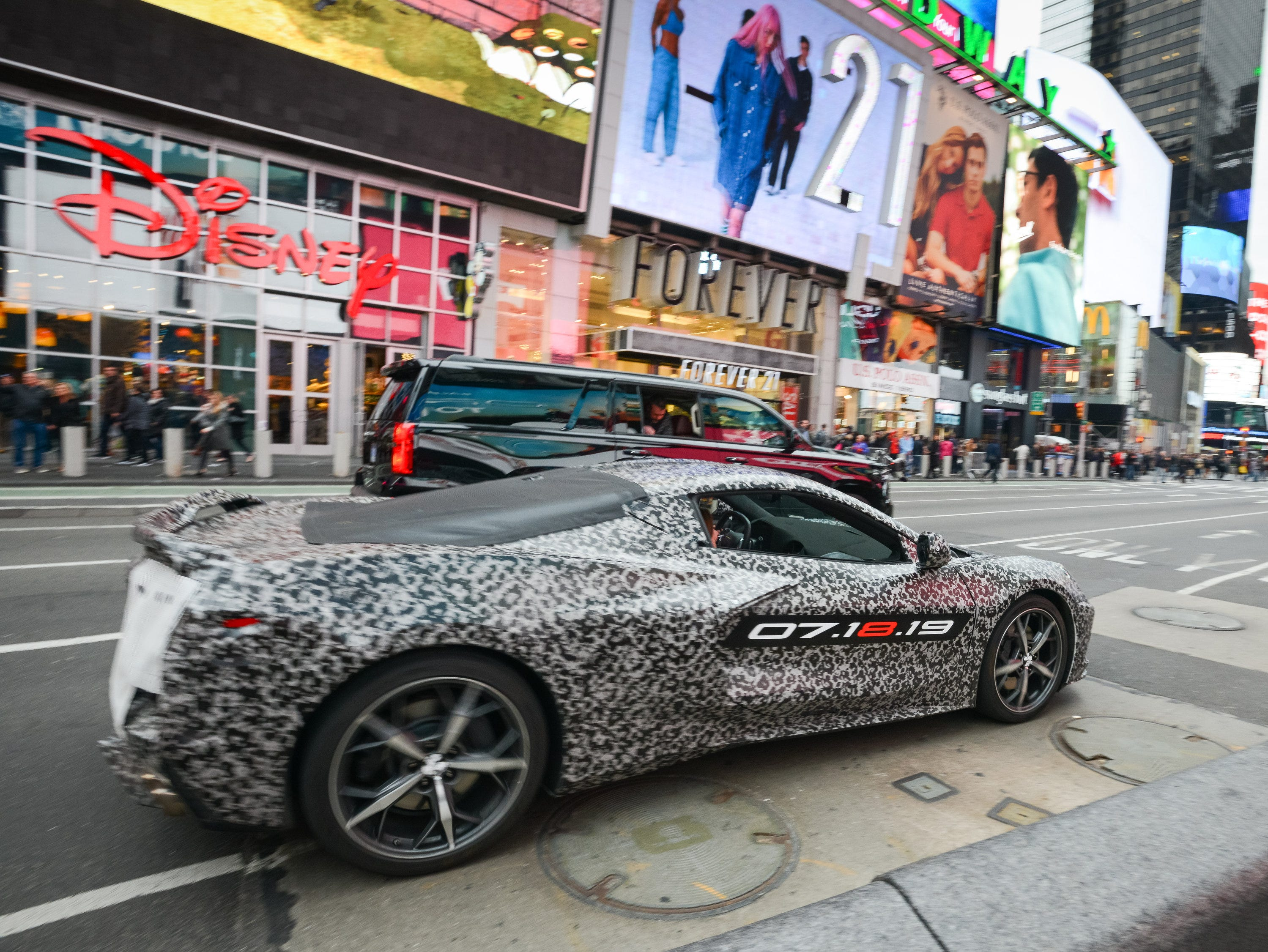 Chevrolet announces the next generation Corvette will debut 07.18.19. A camouflaged next generation Corvette travels down 7th Avenue near Times Square Thursday, April 11, 2019 in New York, New York.