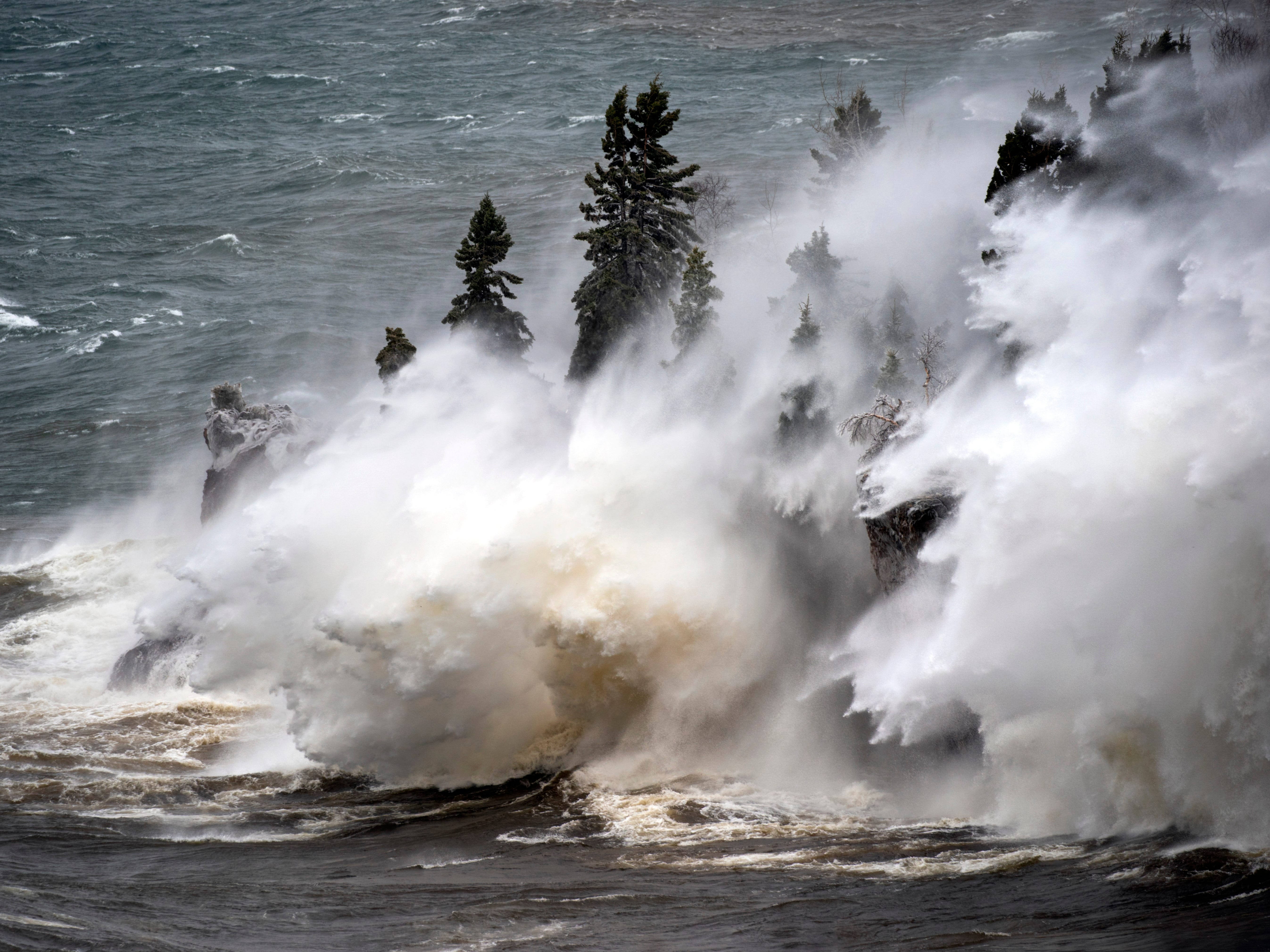 Waves pound the shoreline at Tettegouche State Park Thursday, April 11, 2019 at Silver Bay, Minn. Wind gusts were up to 50 miles per hour.