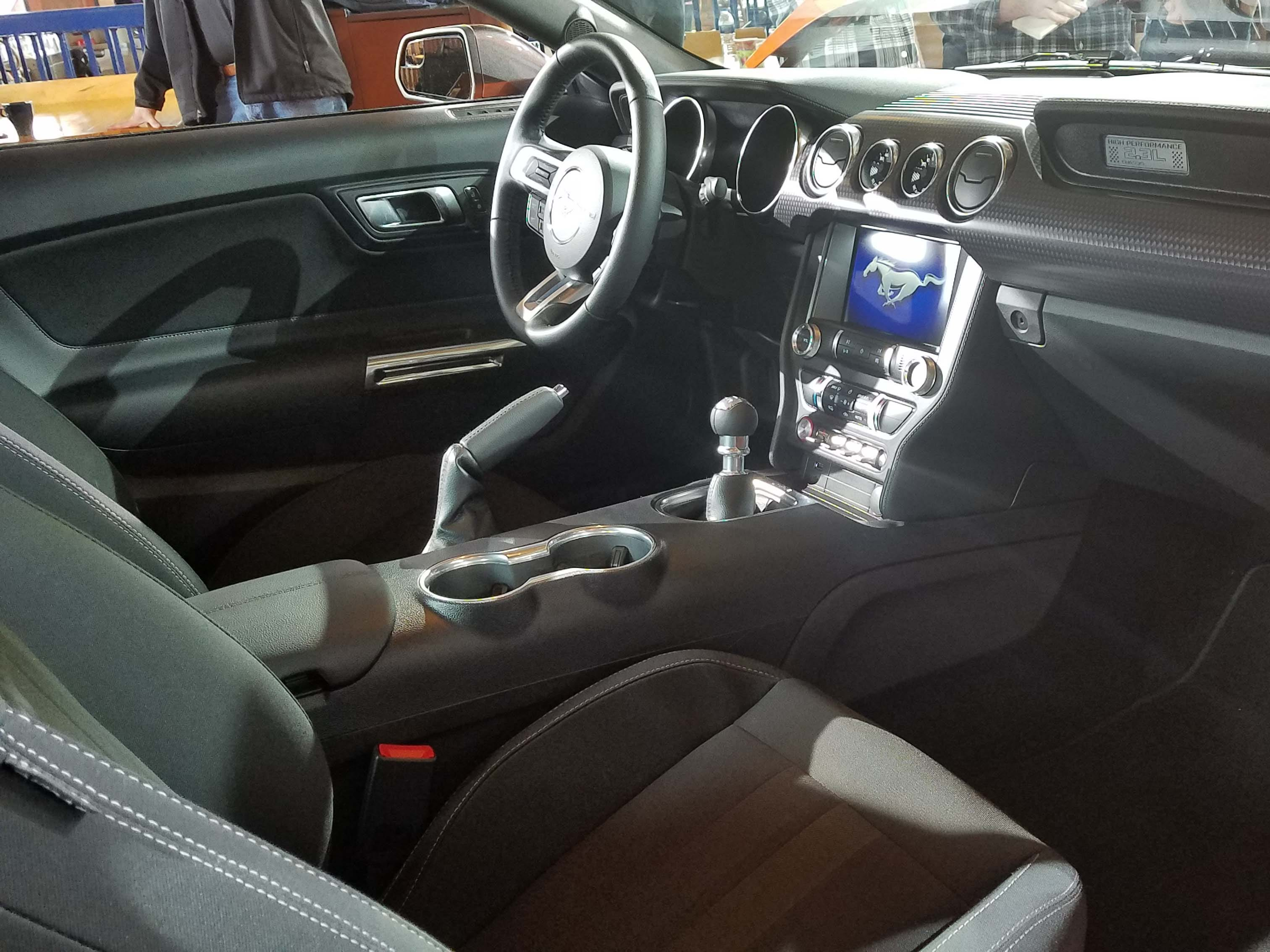 Like all Mustangs, the interior of the Ford Mustang Ecoboost High Performance comes optioned with leather seats, bigger console screen and digital tech.