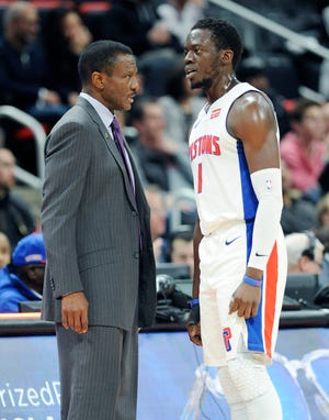 Dwane Casey, left, helped guide Reggie Jackson and the Pistons to the playoffs for the second time this decade in his first year as head coach.