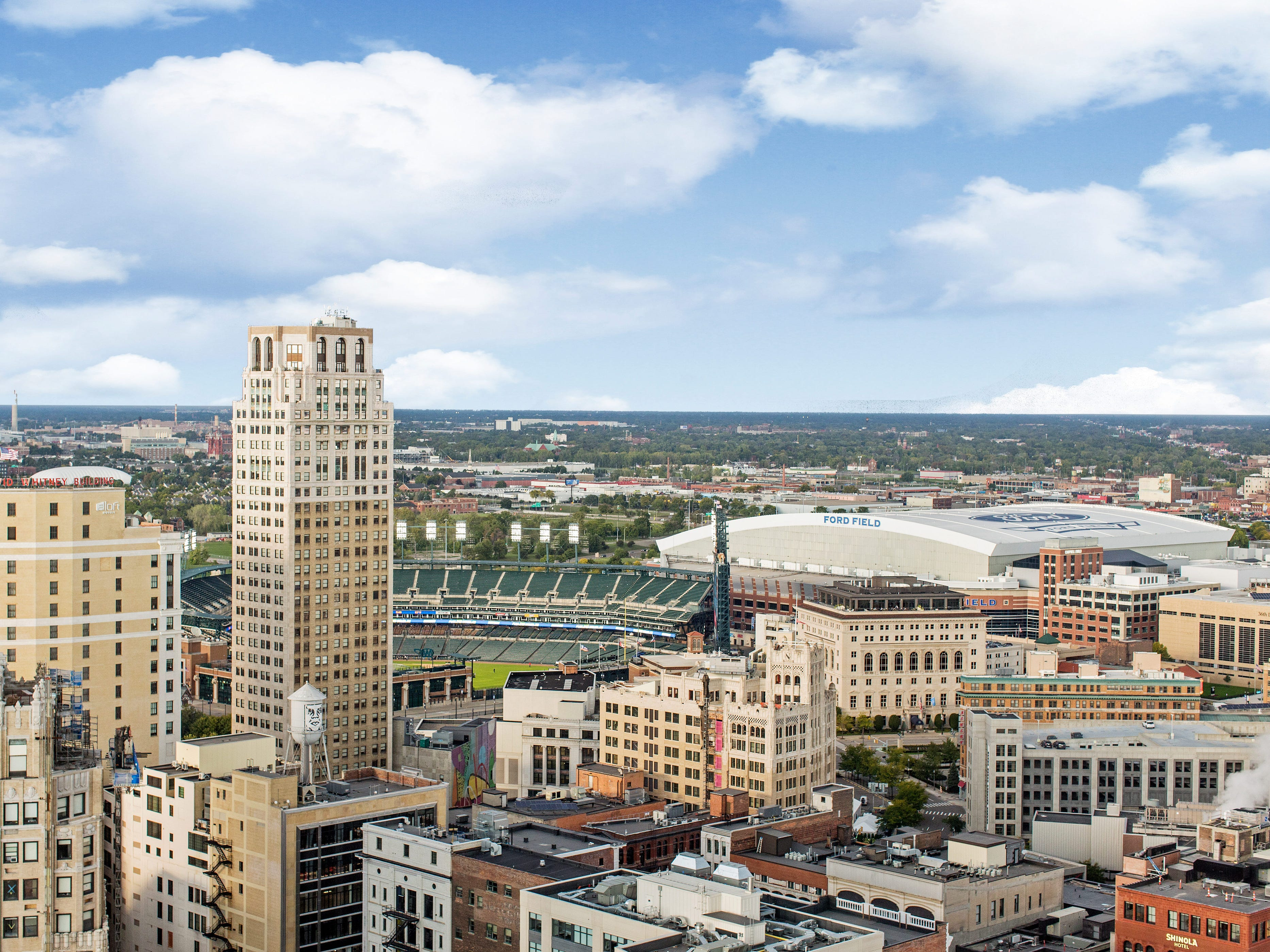 The view of the Detroit skyline is absolutely stunning from this penthouse condo at the top of the Westin Book Cadillac hotel building as Comerica Park and Ford Field are seen here.