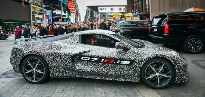 Chevrolet Corvette Chief Engineer Tadge Juechter and General Motors Chairman and CEO Mary Barra drive in a camouflaged next generation Corvette down 7th Avenue near Times Square Thursday, April 11, 2019 in New York City.