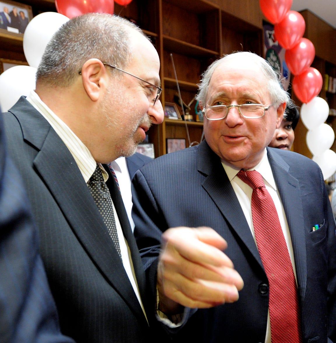 Detroit News Publisher Jon Wolman, left, talks with US Senator Carl Levin.