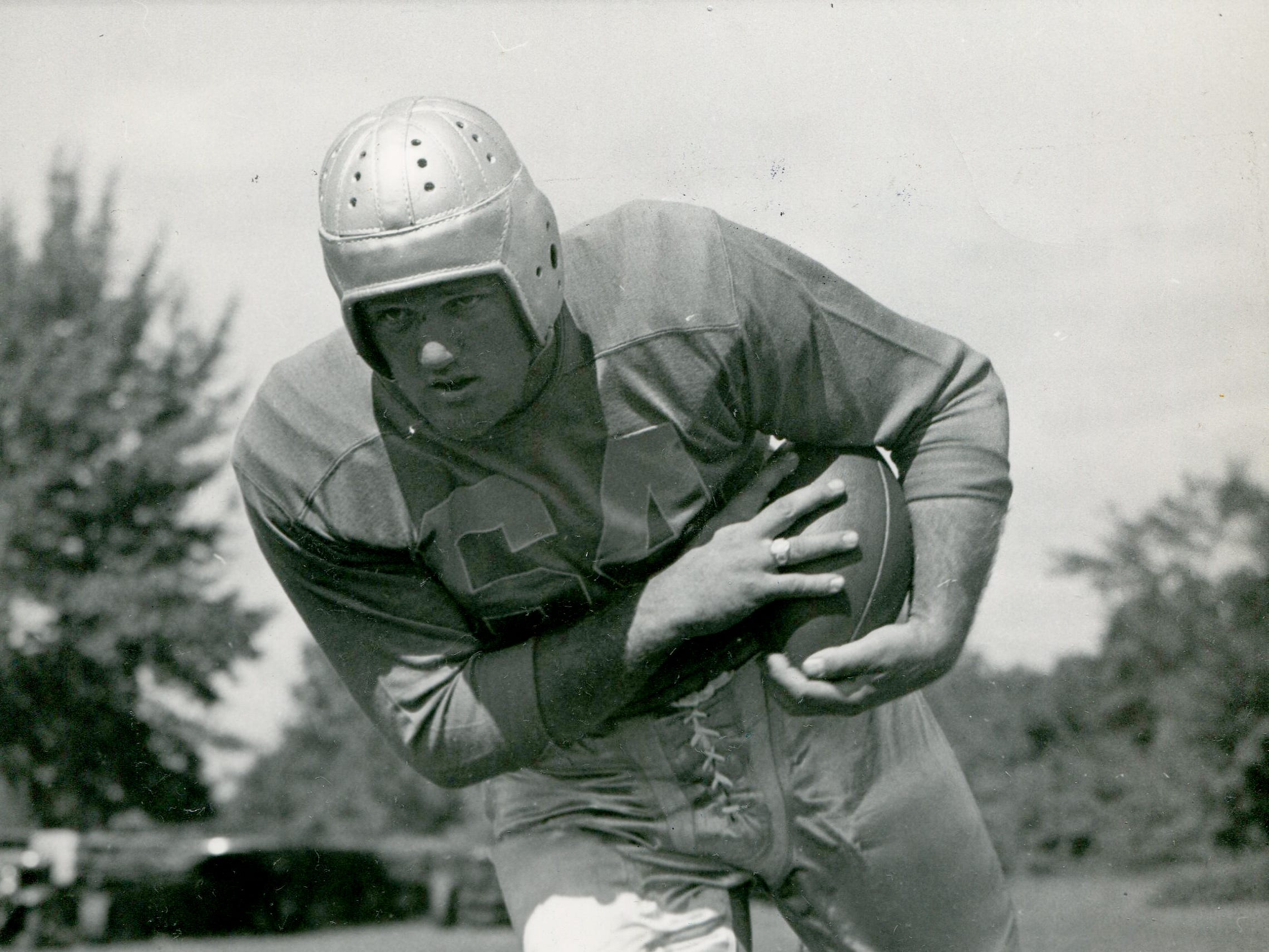 This bruiser was Ivan Trebotich, running back for the Detroit Lions. Imposing as he looked, he had only one rushing attempt in 1944, for a 2-yard gain.