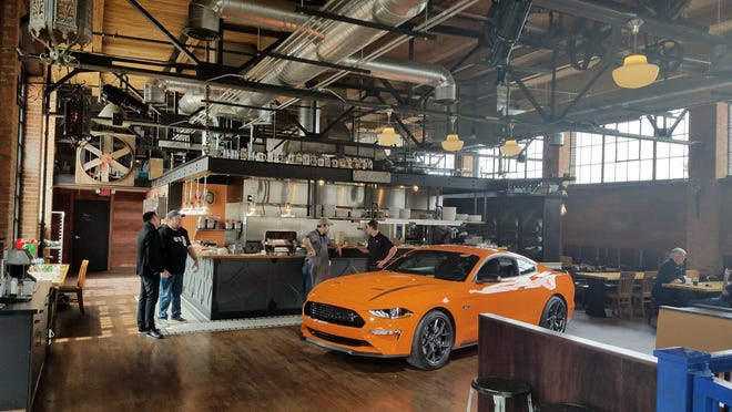 Ford debuted the Ford Mustang Ecoboost High Performance to media at the Cork &  Gabel restaurant in Corktown across from Ford's new train station tech building.