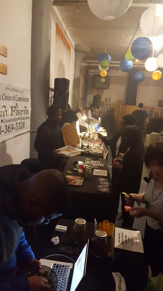 Vendors provide marijuana and marijuana edibles at a Buds, Corks and Forks event in Detroit. Mitzi Ruddock, who runs the the social use club, is advocating for programs that assist potential marijuana business licensees who are from a community disproportionately impacted by past marijuana arrests.