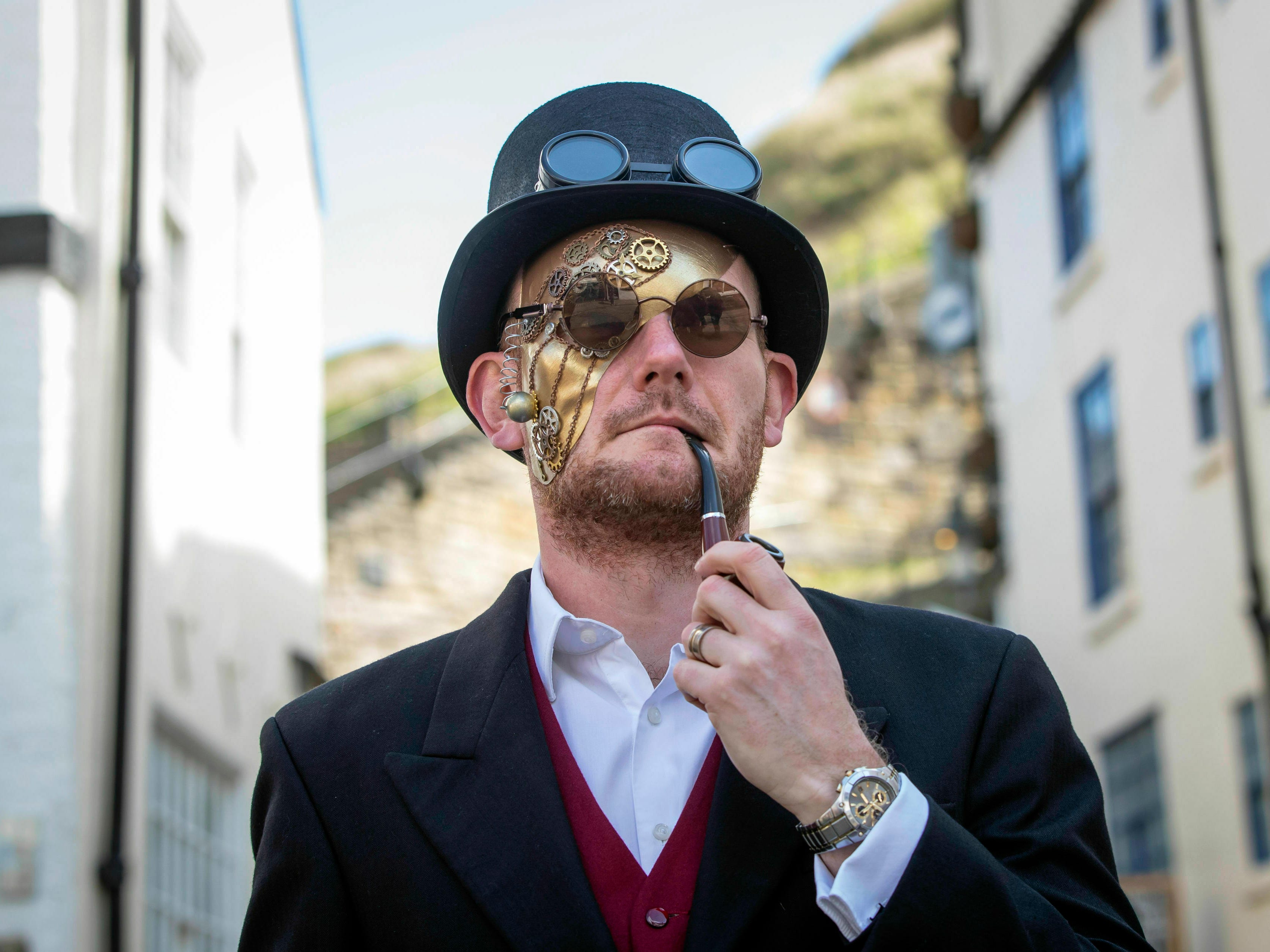 A man attends the Whitby Goth Weekend in Whitby, north England, Friday April 12, 2019, where Bram Stoker reputedly found some of his inspiration for the 'Dracula' story after staying in the town in 1890. The Whitby Goth Weekend is a twice-yearly alternative music festival which has grown to be one of the world's most popular goth events attracting attendees from across the globe.
