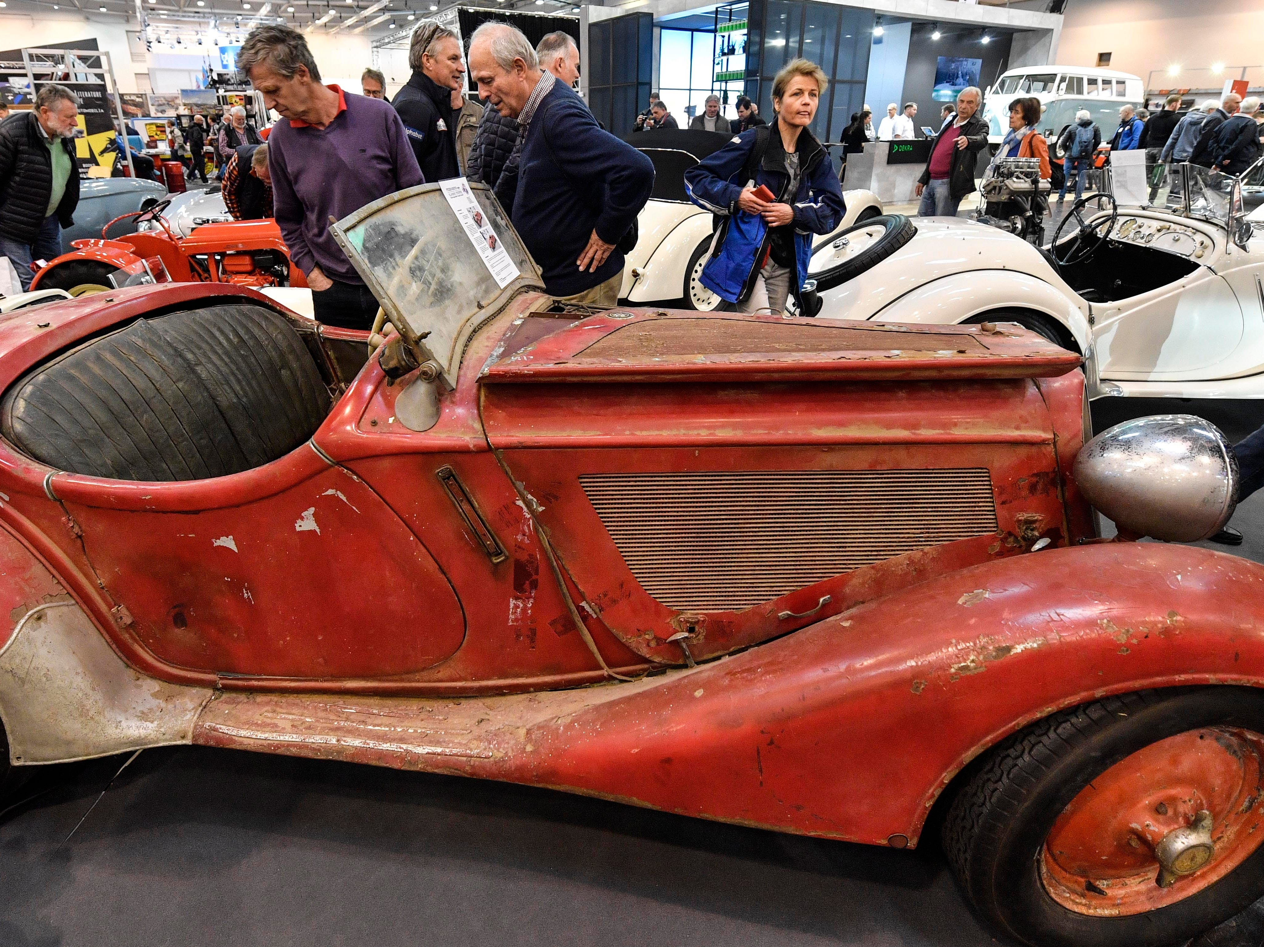 Visitors look at a 1938 BMW 328 Roadster ready for restoration at the World Show for Vintage, Classic and Prestige Automobiles Techno-Classica in Essen, Germany, Friday, April 12, 2019.