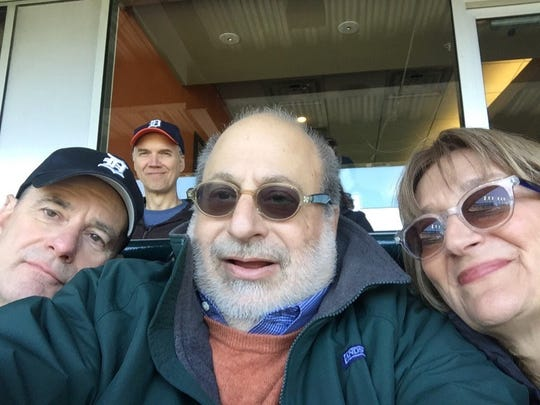 Editorial Page Editor Nolan Finley, left, and Publisher Jon Wolman grab a selfie at a chilly Tigers game alongside former UM Regent Andrea Fischer Newman.