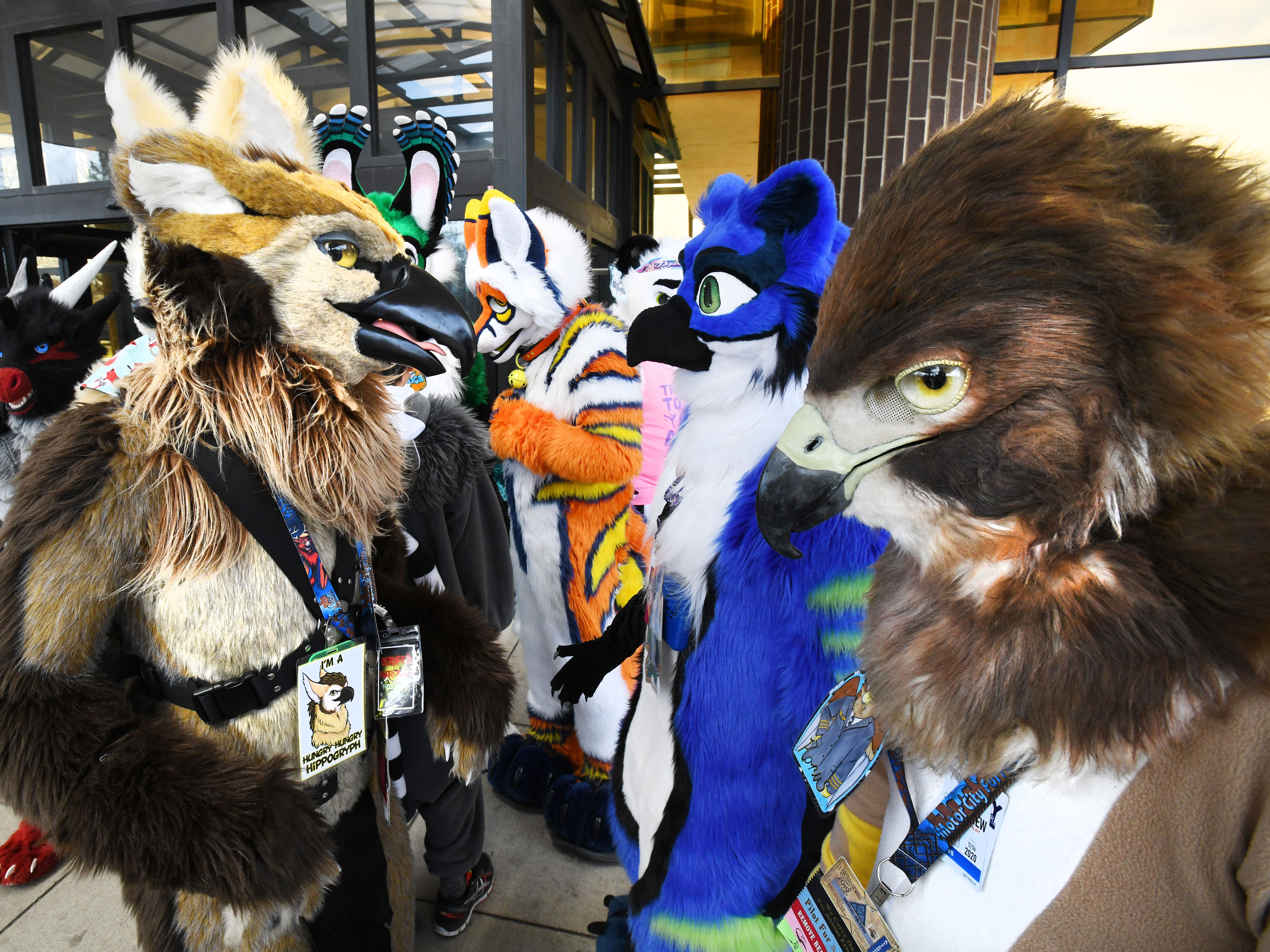 Birds of a feather do flock together outside the Westin Detroit-Southfield hotel, Friday, April 12, 2019, for the 2019 Motor City Furry Convention that runs through the weekend. The convention is Michigan's 18+ anthropomorphic appreciation convention for furries and furry fans alike.  More info at https:/motorcityfurrycon.org/