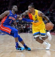 Bucks guard Eric Bledsoe, right, is going to be a handful for Reggie Jackson and the other Pistons guards to slow down.