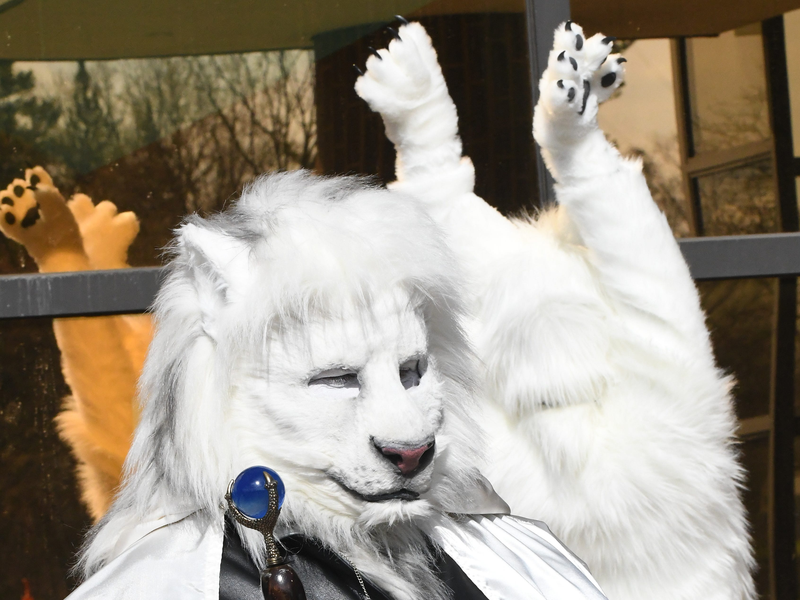A regal furry outside the 2019 Motor City Furry Con at the Westin Detroit-Southfield in Southfield on April 12, 2019. Motor City Furry Convention is Michigan's 18+ anthropomorphic appreciation convention for furries and furry fans alike.