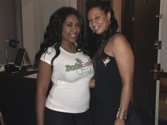 Mitzi Ruddock, right, is pictured with hostess Sierra at a Buds, Corks and Forks event in Detroit. Ruddock, who runs the social use club, is advocating for programs that assist potential marijuana business licensees who are from a community disproportionately impacted by past marijuana arrests.