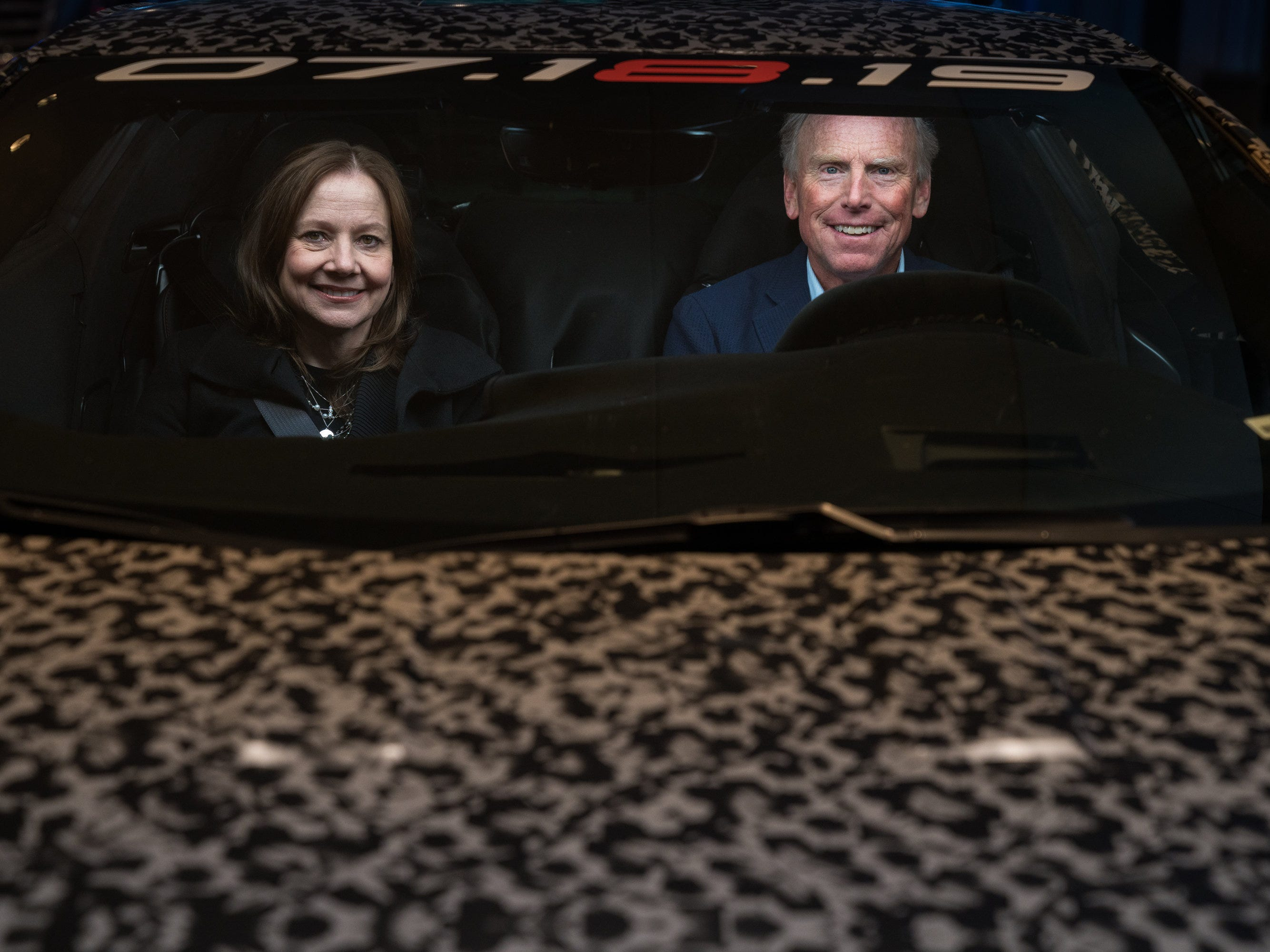 General Motors Chairman and CEO Mary Barra and Corvette Chief Engineer Tadge Juechter inside a camouflaged next generation Chevrolet Corvette.