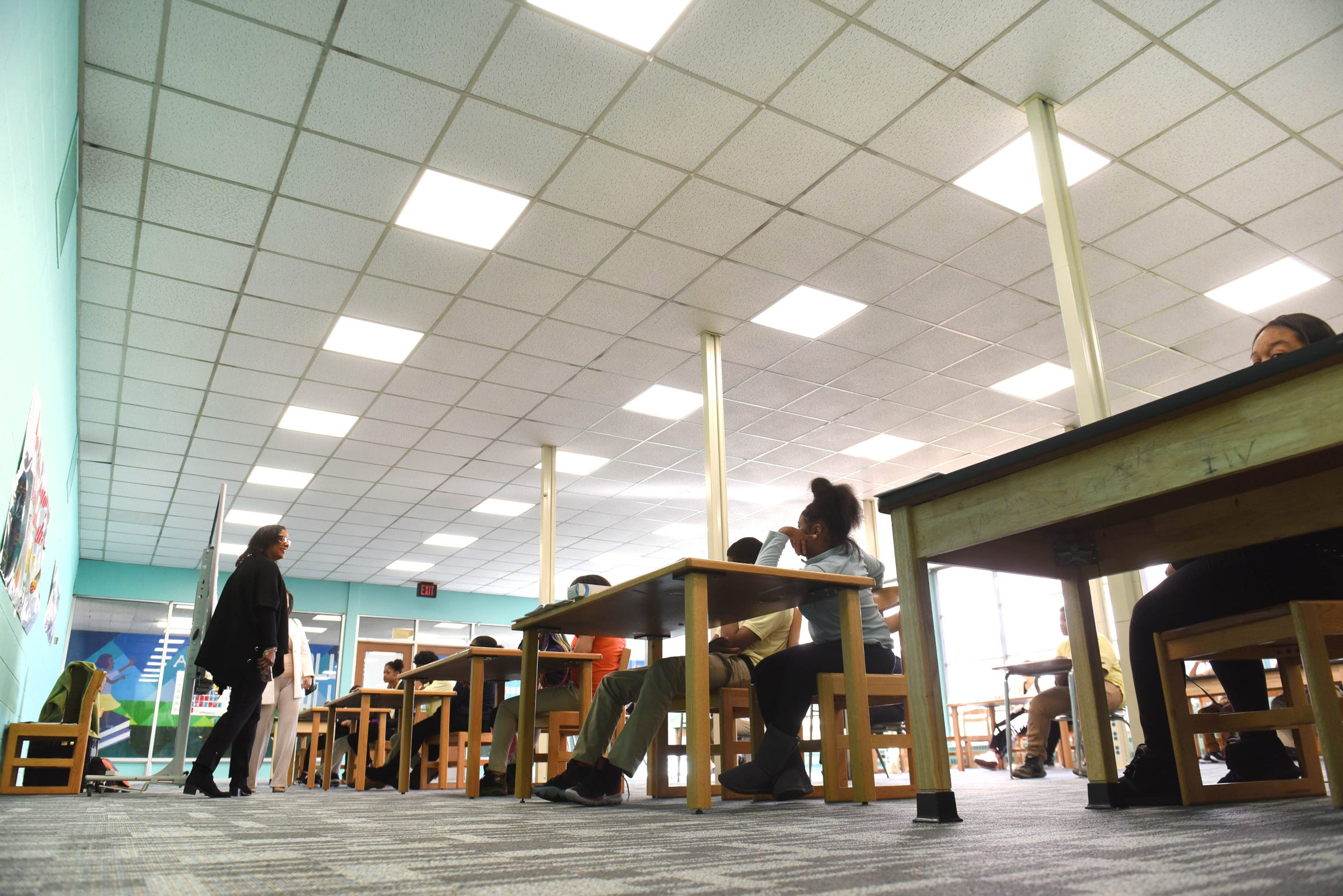 Palmer Park Preparatory Academy students prepare for a test in the professional learning center. The school  recently installed LED lighting, drop ceiling and carpeting, but according to a 2018 assessment, needs $25.87 million in facilities repairs.