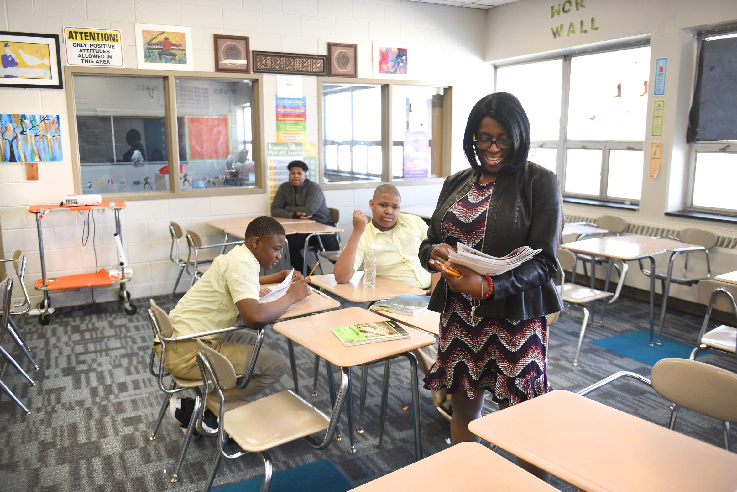 Palmer Park Preparatory Academy teacher Dorothy Crane works with students in one of the many refurbished classrooms at the school.  But according to a 2018 assessment, the building needs $25.87 million in facilities repairs.