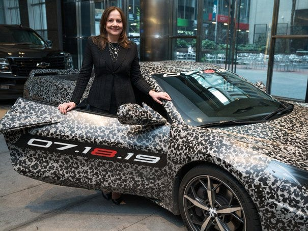 General Motors Chairman and CEO Mary Barra and a camouflaged next generation Chevrolet Corvette Thursday, April 11, 2019 in New York, New York. The next generation Corvette will be unveiled on July 18.