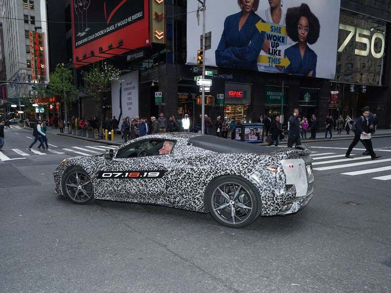 Corvette Chief Engineer Tadge Juechter drives May Barra around Time Square in New York Thursday in a mid-engine Corvette. Barra announced at a gala for the Stephen Siller Tunnel to Towers Foundation that the next-gen C8 'Vette will debut July 18 in its birthday suit.