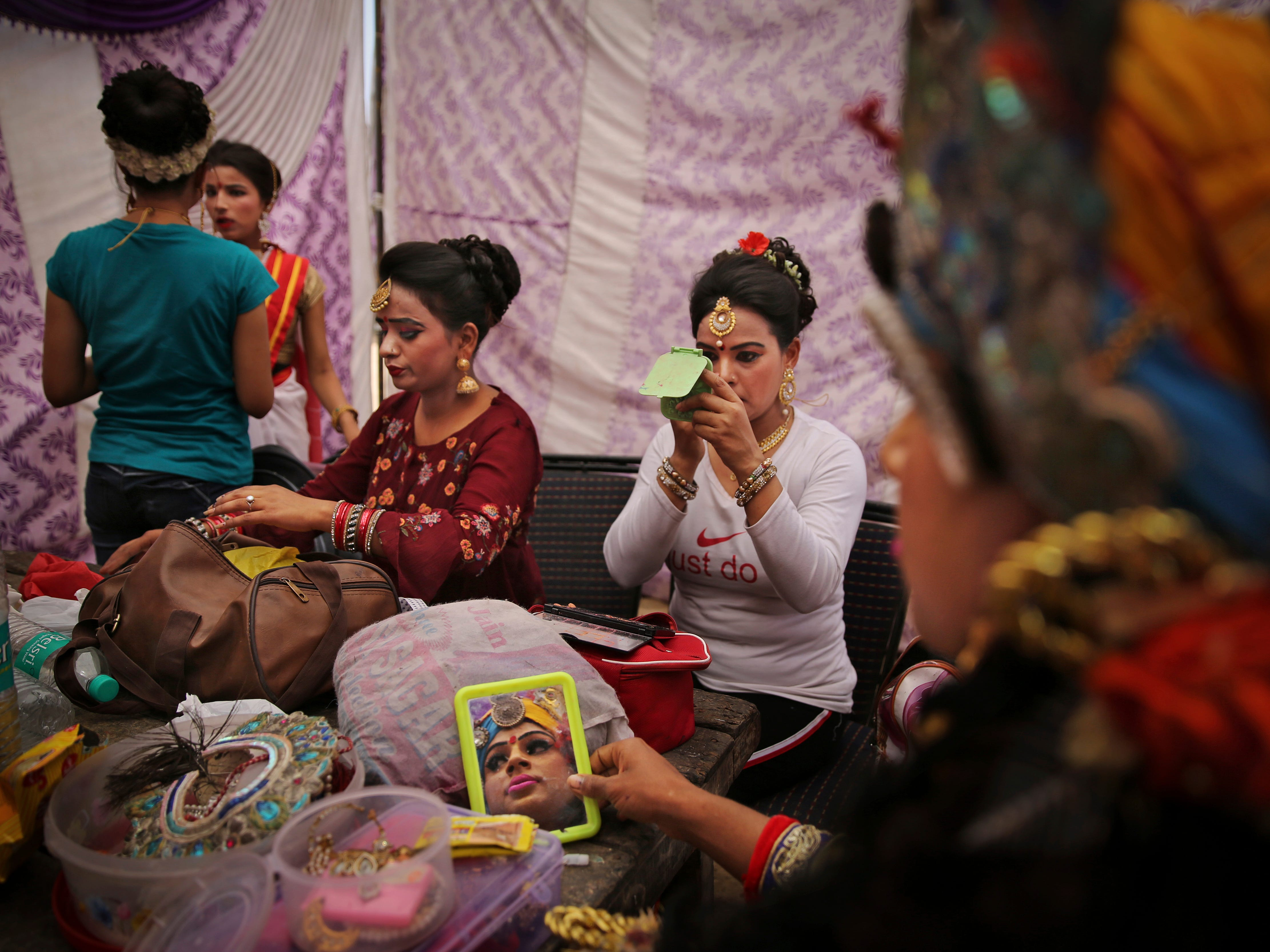 Indian artists prepare backstage for a religious procession on Ram Navami, a major Hindu festival celebrating the birth of the Hindu god Rama, in New Delhi, India, Friday, April 12, 2019. Tens of thousands of devotees attend street processions displaying Rama's life story in colorful tableaux, including statues of infant Rama in a cradle.