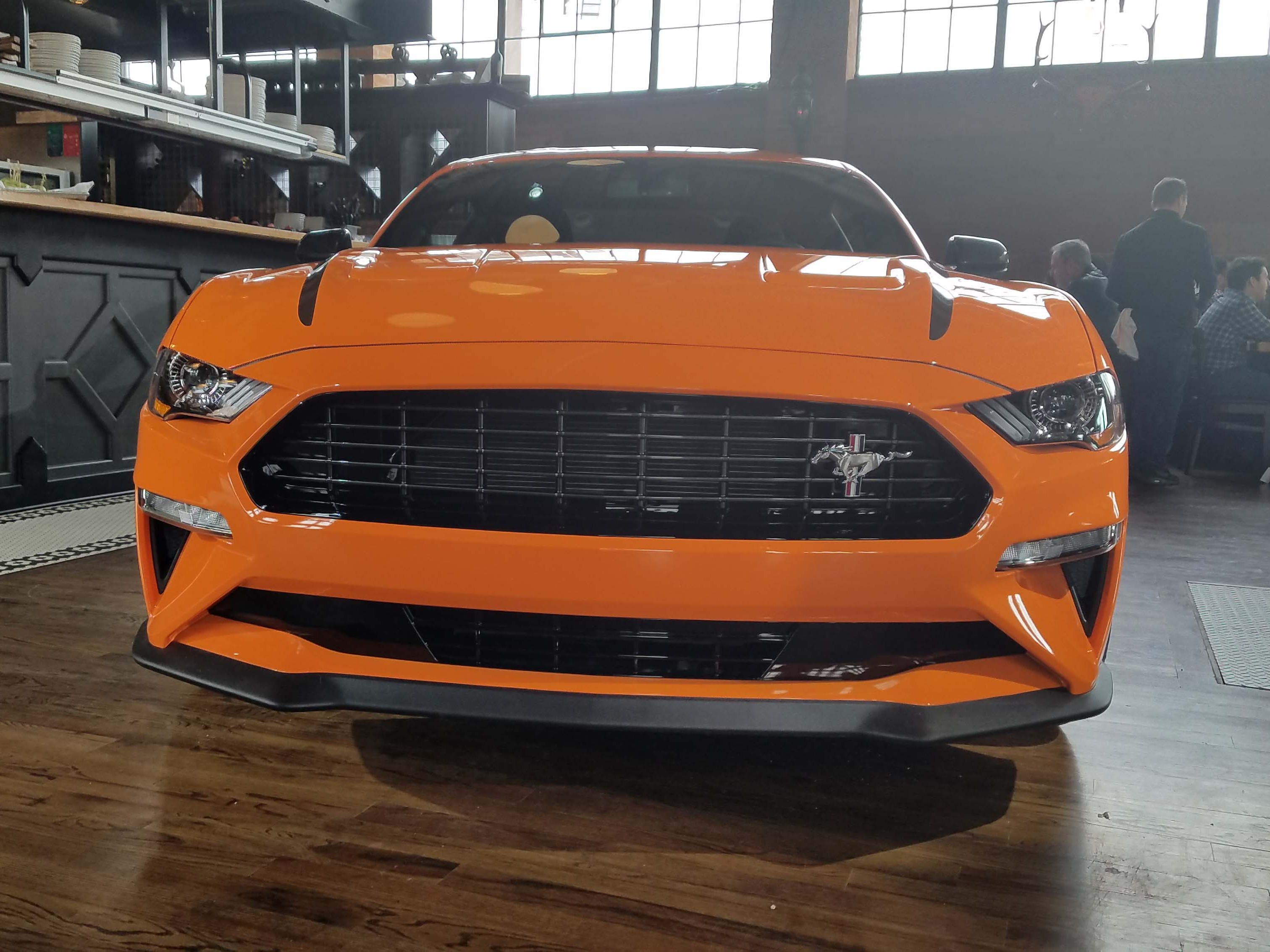The Ford Mustang Ecoboost High Performance is distinguished by its black-out mesh grille and front splitter.
