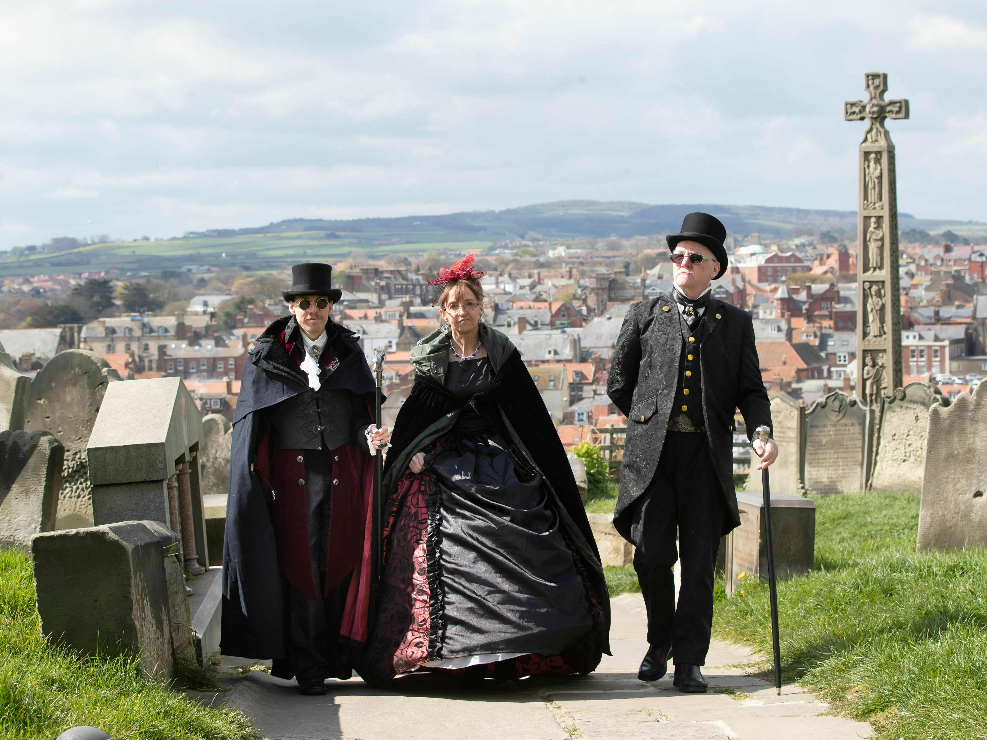 People attend the Whitby Goth Weekend in Whitby, north England, Friday April 12, 2019, where Bram Stoker reputedly found some of his inspiration for the 'Dracula' story after staying in the town in 1890. The Whitby Goth Weekend is a twice-yearly alternative music festival which has grown to be one of the world's most popular goth events attracting attendees from across the globe.