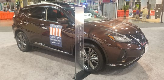 "A Nissan Murano bears a ""Built in Mississippi"" sign."