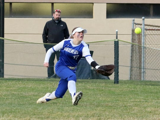 Horseheads center fielder Emma Loomis makes a diving catch against Elmira on April 11, 2019 at Ernie Davis Academy.