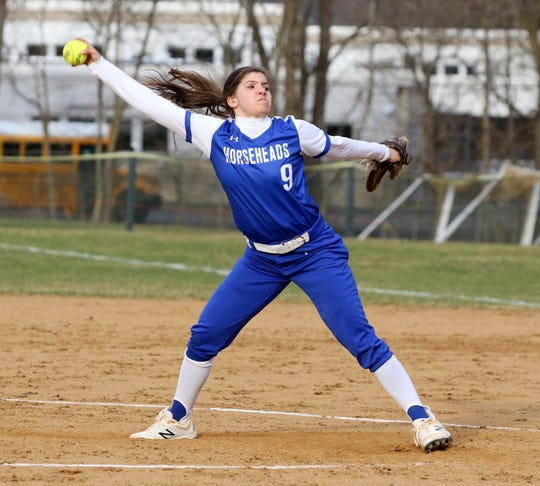 Maddie Rogers delivers a pitch for Horseheads against Elmira in softball April 11, 2019 at Ernie Davis Academy.