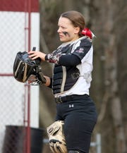 Elmira catcher Sarah Coon puts her mask back on against Horseheads on April 11, 2019 at Ernie Davis Academy.