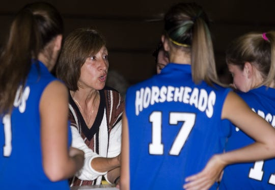 Patti Perone talks her team during a match in 2008.