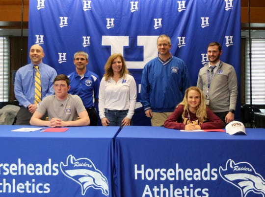 Horseheads seniors Devin Woodworth and Madison Klein with their coaches at a signing ceremony April 11, 2019 at Horseheads High School. In the back, from left, are Horseheads wrestling coaches Brett Owen and Troy Monks, and running coaches Terri Gill, Terry Malloy and Adam McDermott.