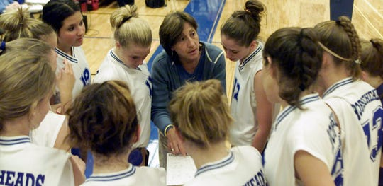 Horseheads volleyball coach Patti Perone talks to her team during a timeout in 2004.