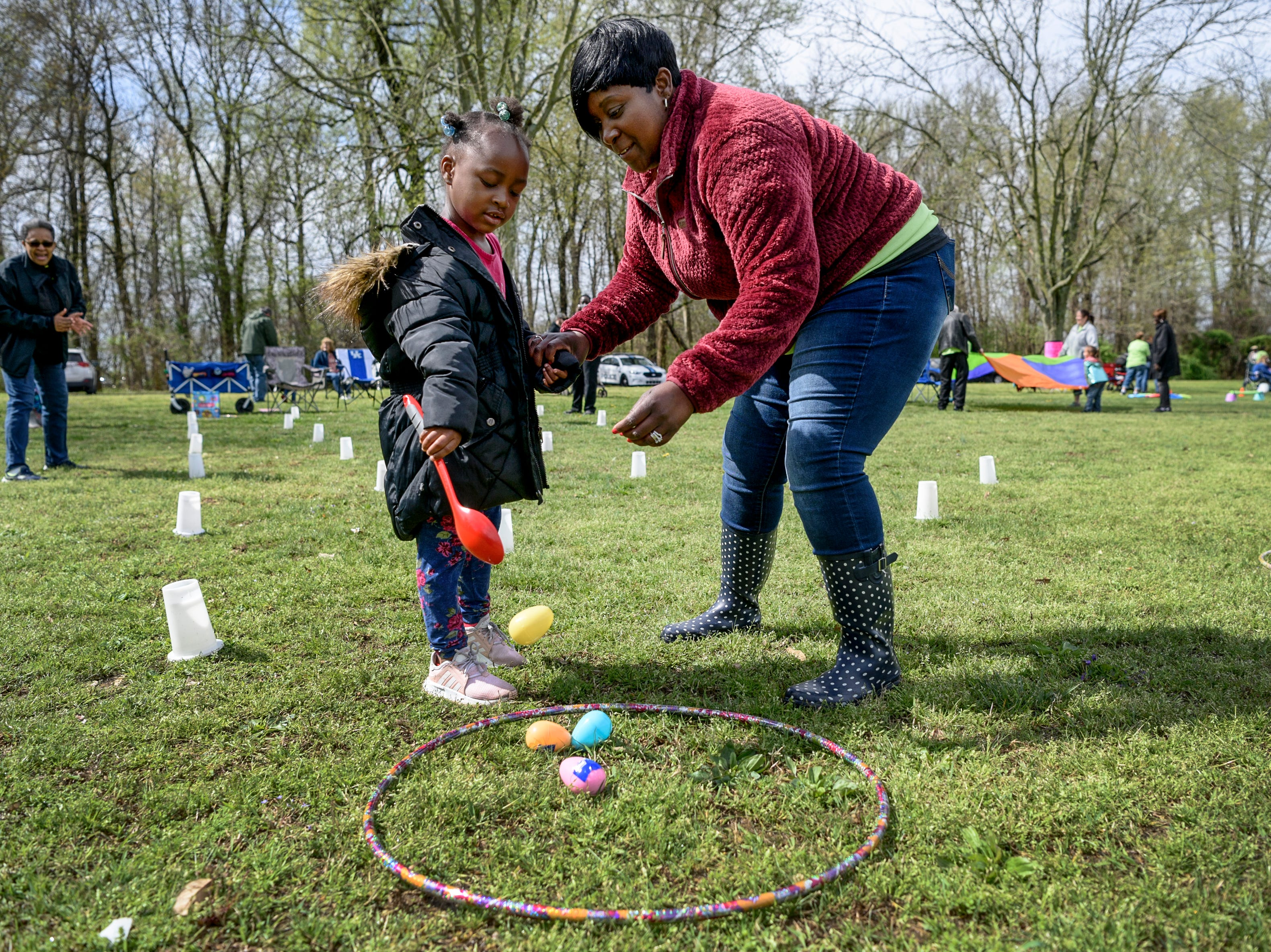 Amira Clemmons, 4, gets help from Jamie Douglas at the egg run station during the annual Family Fun day for the Community Action Program of Evansville & Vanderburgh County, Inc. (CAPE) Head Start and Early Head Start Early Childhood Education programs at Wesselman Park in Evansville, Ind., Friday, April 12, 2019.