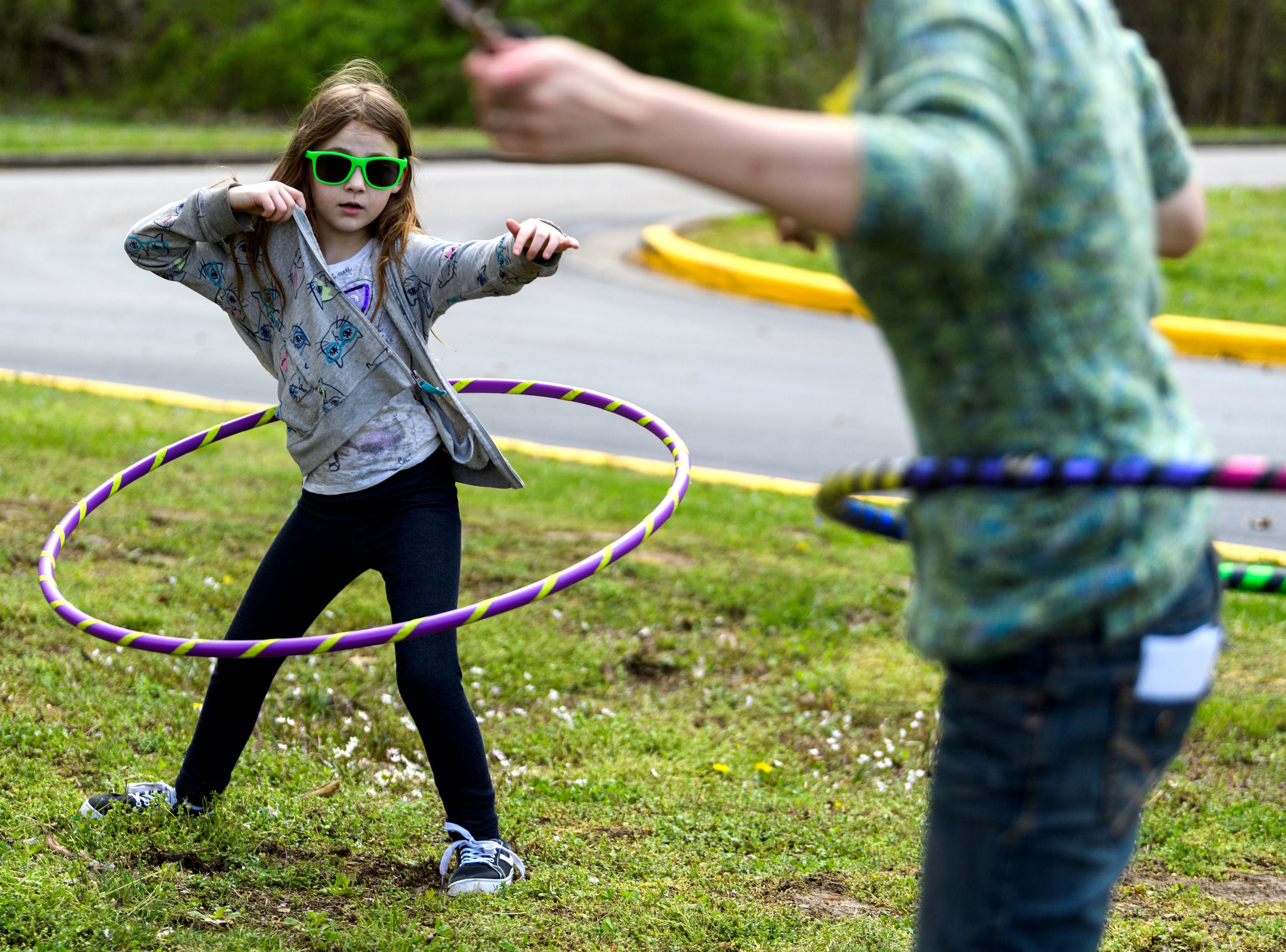"""Danika Goodridge, 8, and her mother Kourtney Harper, right, compete to see who can hula hoop the longest during the Community Action Program of Evansville & Vanderburgh County, Inc. (CAPE) Family Fun Day at Wesselman Park in Evansville, Ind., Friday, April 12, 2019. """"We should be in a professional contest,"""" Harper said."""