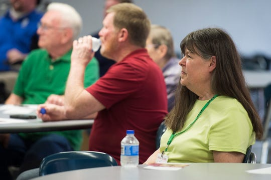 Connie Whitman sits through a Plaza Park Neighborhood Association meeting Thursday, April 11, 2019. Whitman is an Independent, running as a Republican, against Evansville  Mayor Lloyd Winnecke.