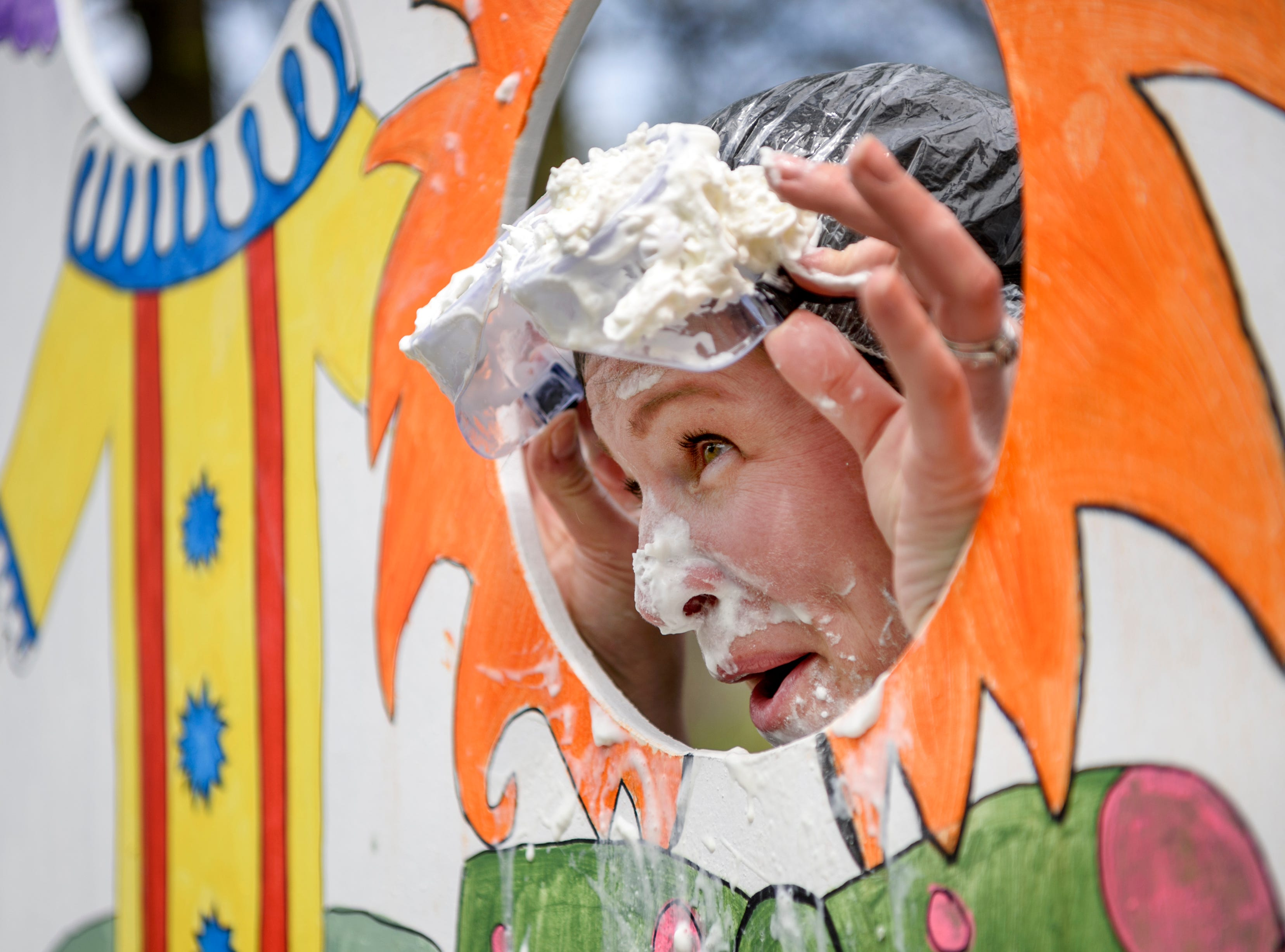 Billie Walker volunteers to continually have whipped cream smashed in her face to raise money for the Community Action Program of Evansville & Vanderburgh County, Inc. (CAPE) Head Start Childhood Education programs during CAPE's annual end of the year Family Fun Day at Wesselman Park in Evansville, Ind., Friday, April 12, 2019.