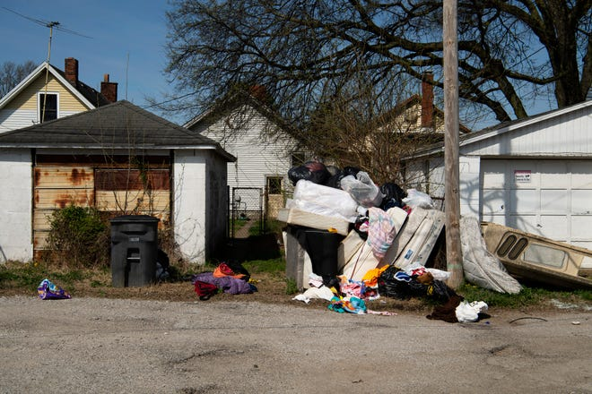 Piles of discarded mattresses are commonplace in the alleys and even front yards of Jimtown residents when landlords remove evicted families' belongings.