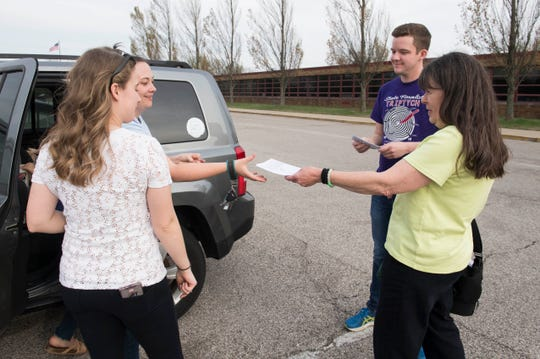 Connie Whitman, right, hands out campaign fliers to EVSC teachers in the parking lot of Plaza Park International Prep Academy Tuesday, April 11, 2019. Whitman is an Independent, running as a Republican, against Evansville  Mayor Lloyd Winnecke.