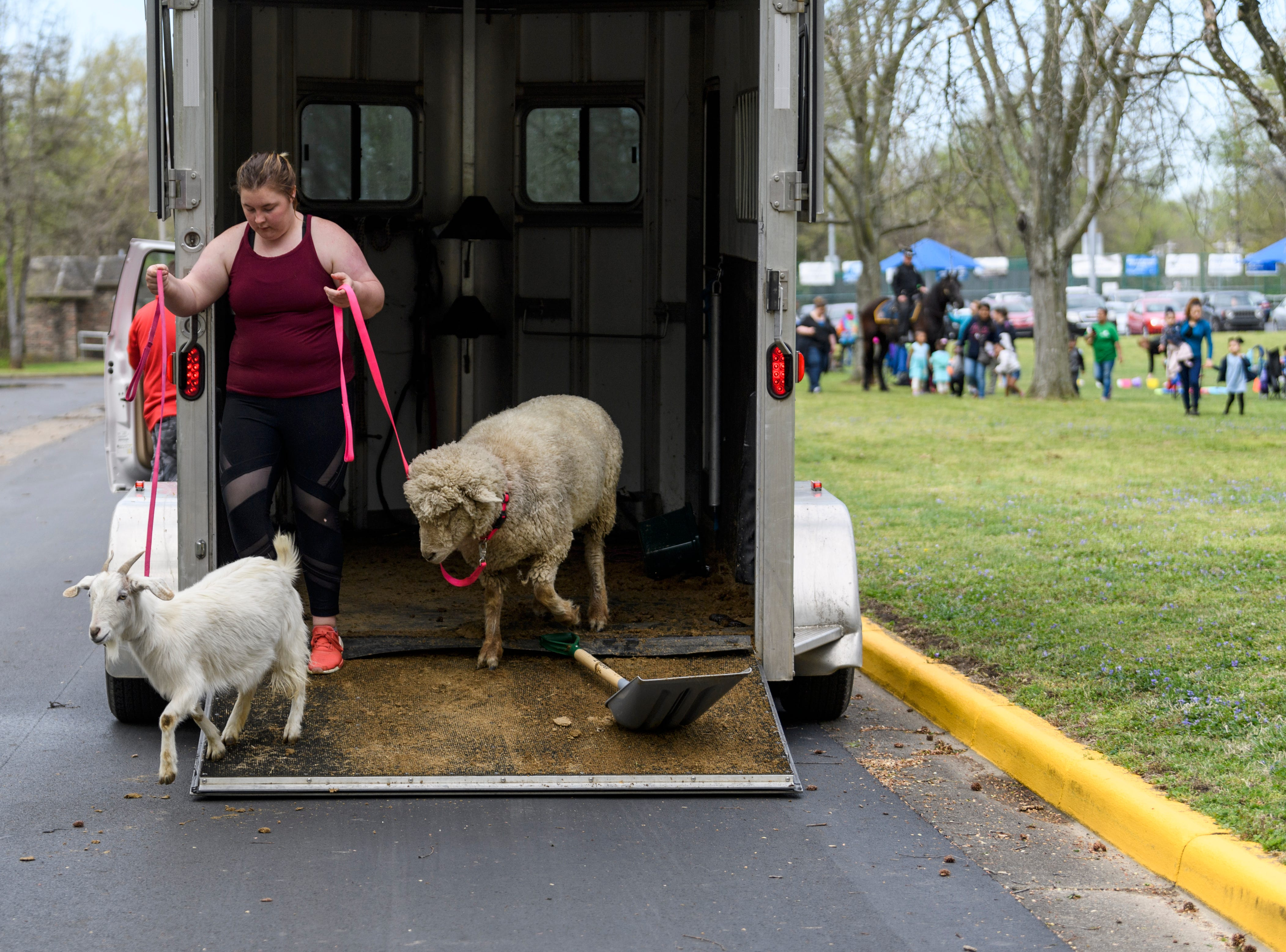 Emily Rexing of Lil' Rexing's Pony Express leads a goat and a sheep to the petting zoo ring set up for the annual Family Fun Day for the Community Action Program of Evansville & Vanderburgh County, Inc. (CAPE) Head Start and Early Head Start Early Childhood Education programs at Wesselman Park in Evansville, Ind., Friday, April 12, 2019.