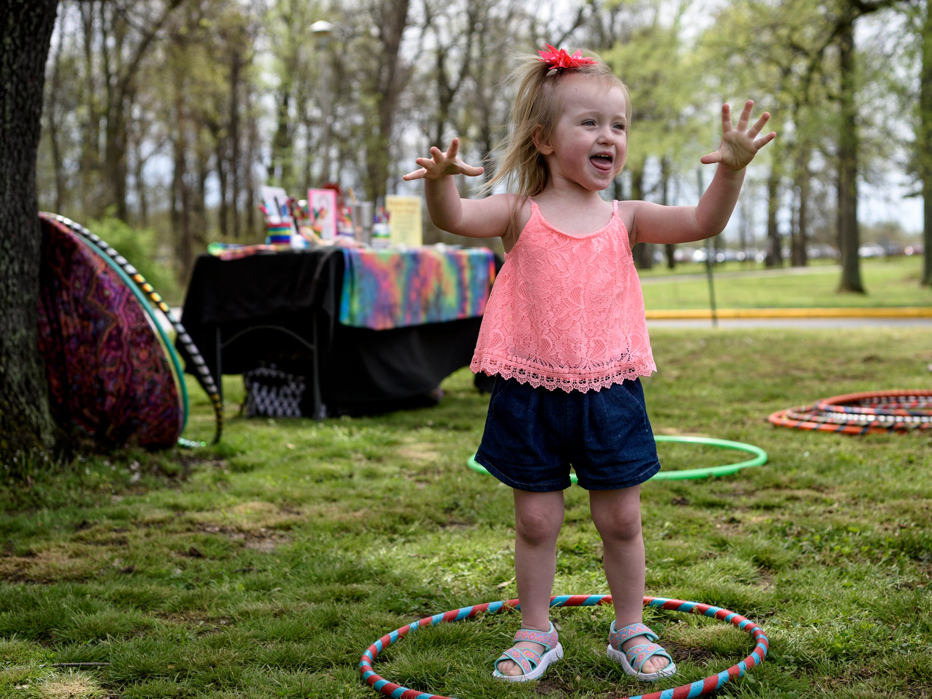 Alexis Ellis, 2, reacts to her hula hoop falling to the ground during the annual Family Fun Day for the Community Action Program of Evansville & Vanderburgh County, Inc. (CAPE) Head Start and Early Head Start Early Childhood Education programs at Wesselman Park in Evansville, Ind., Friday, April 12, 2019.