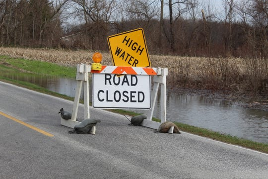 High waters close County Road 259 at Wightman's Grove after heavy winds or rainfall due to poor drainage and a failing dike.
