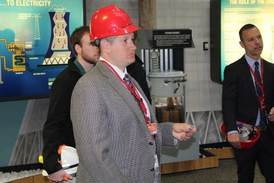 Guy Parmigian, superintendent of Benton-Carroll-Salem Local Schools, listens to a presentation at the Davis-Besse Nuclear Power Station in April. Parmigian and other local officials have been trying to keep the plant open beyond its scheduled 2020 deactivation date.