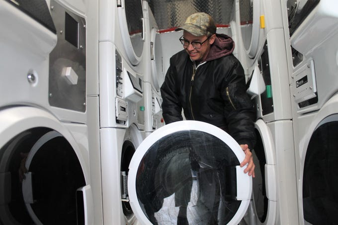 Riley Cockrell showcases the Denver Laundry Truck at Project Homeless Connect in Fort Collins, April 12, 2019. A local group hopes to start serving northern Colorado in this year using a similar model.