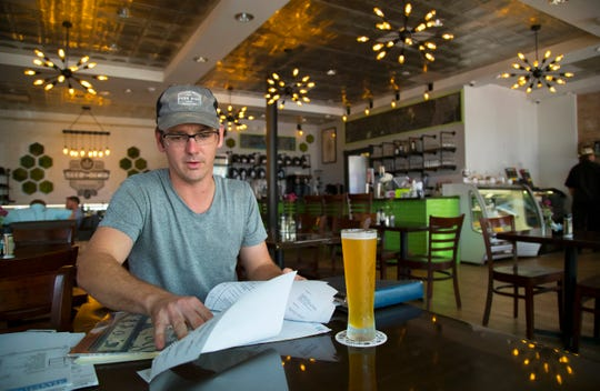 Grayson Hicks, a local contractor, begins his weekend at Seed and Bean Market recently in downtown Fort Myers. The new shop specializes in coffees and teas infused with CBD, a calming and non-psychoactive compound found in marijuana.