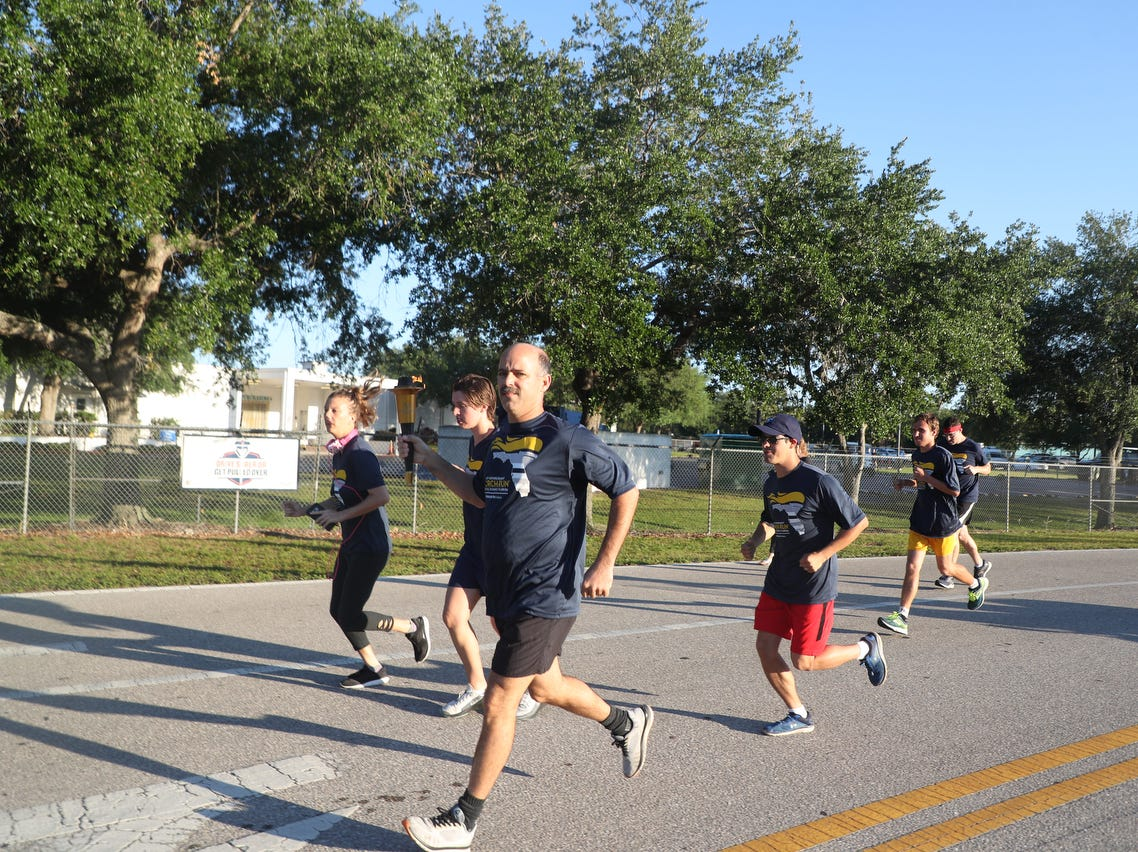 Members of local law enforcement agencies and several Special Olympic athletes took part in the annual Law Enforcement Torch Run on Friday April, 12, 2019. The six mile run benefits Special Olympics. The run starts and finishes at the Lee County Sheriff's Office headquarters and