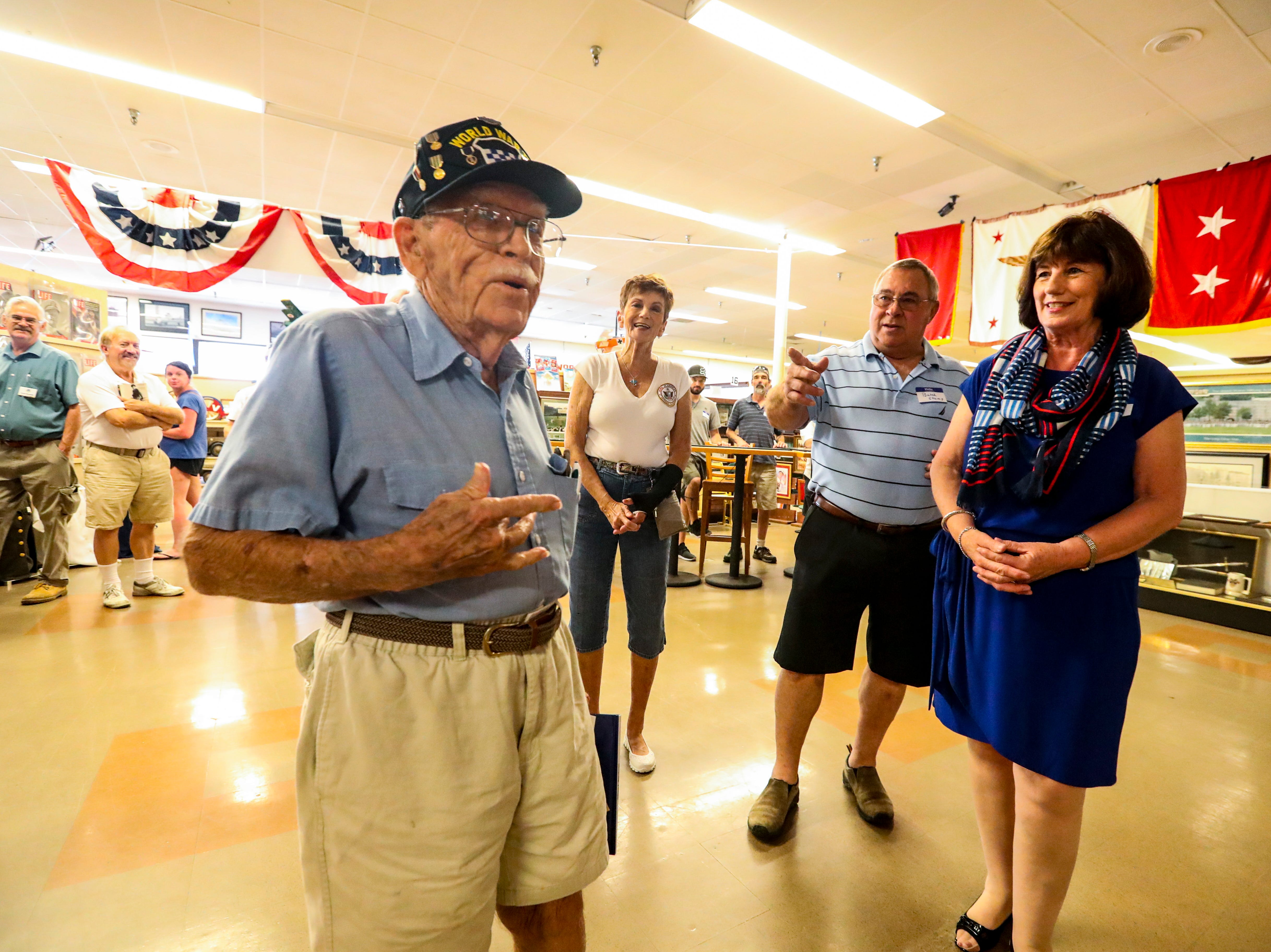 "William Workman turned 97 on April 12, 2019. His family and friends had a surprise birthday party at the Southwest Florida Military Museum in Cape Coral. Bill was with the 99th Division that landed in Europe on Nov. 17, 1944, then shipped to Bastogne. Mary Anne Passatore, of Fort Myers and a volunteer with the museum, sings Bill ""Happy Birthday"" along with Wanda and Butch Stump of Woodbridge, Va. The Stumps have become friends with Workman and they are planning to help him return to Europe to see the battlefields he once fought on."