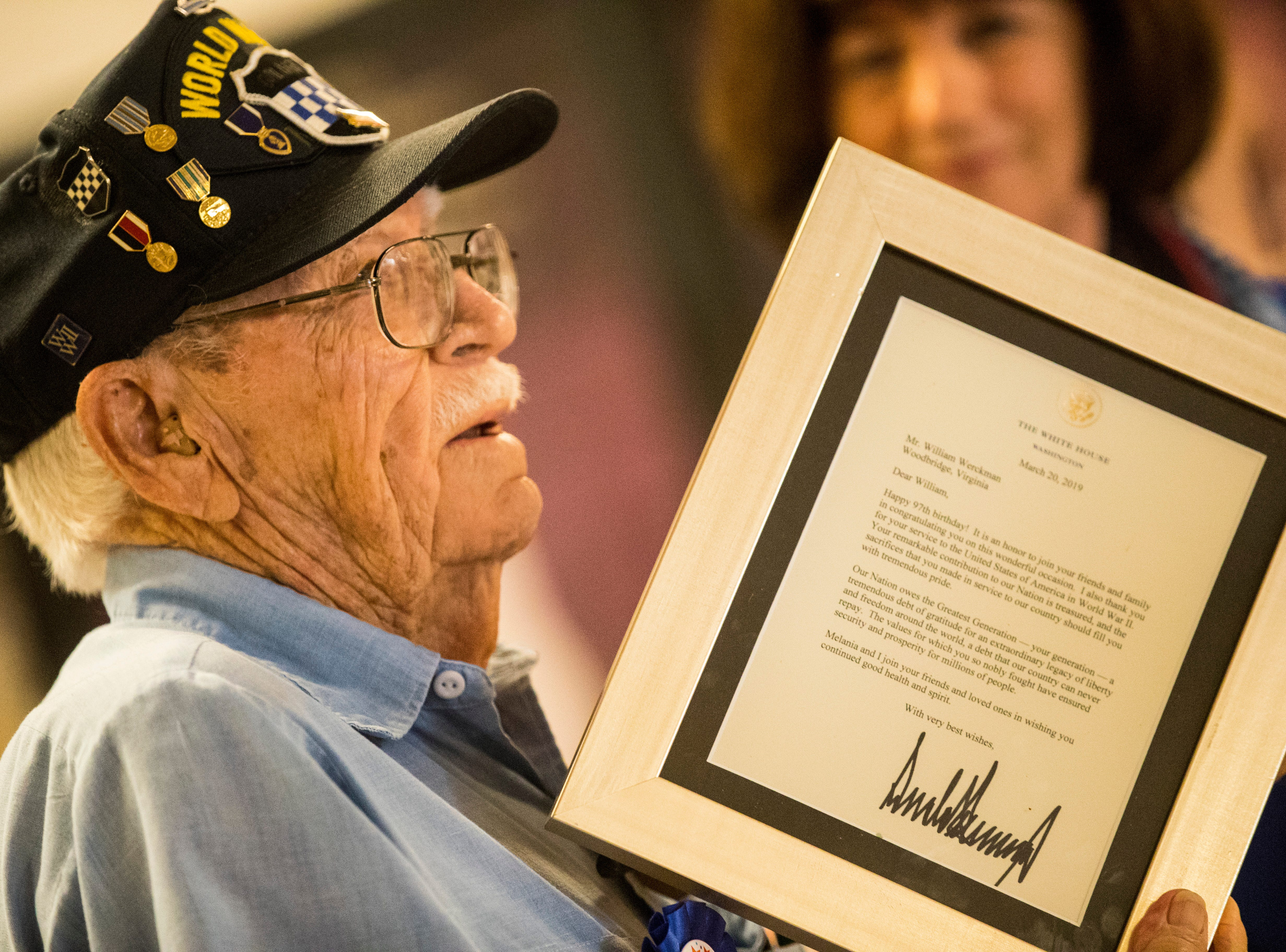 Bill holds a letter from the president of the United States, wishing him a very happy 97th birthday and thanking him for his service. William Workman turned 97. His family and friends had a surprise birthday party at the Southwest Florida Military Museum in Cape Coral. Bill was with the 99th Division that landed in Europe on Nov. 17, 1944, then shipped to Bastogne.