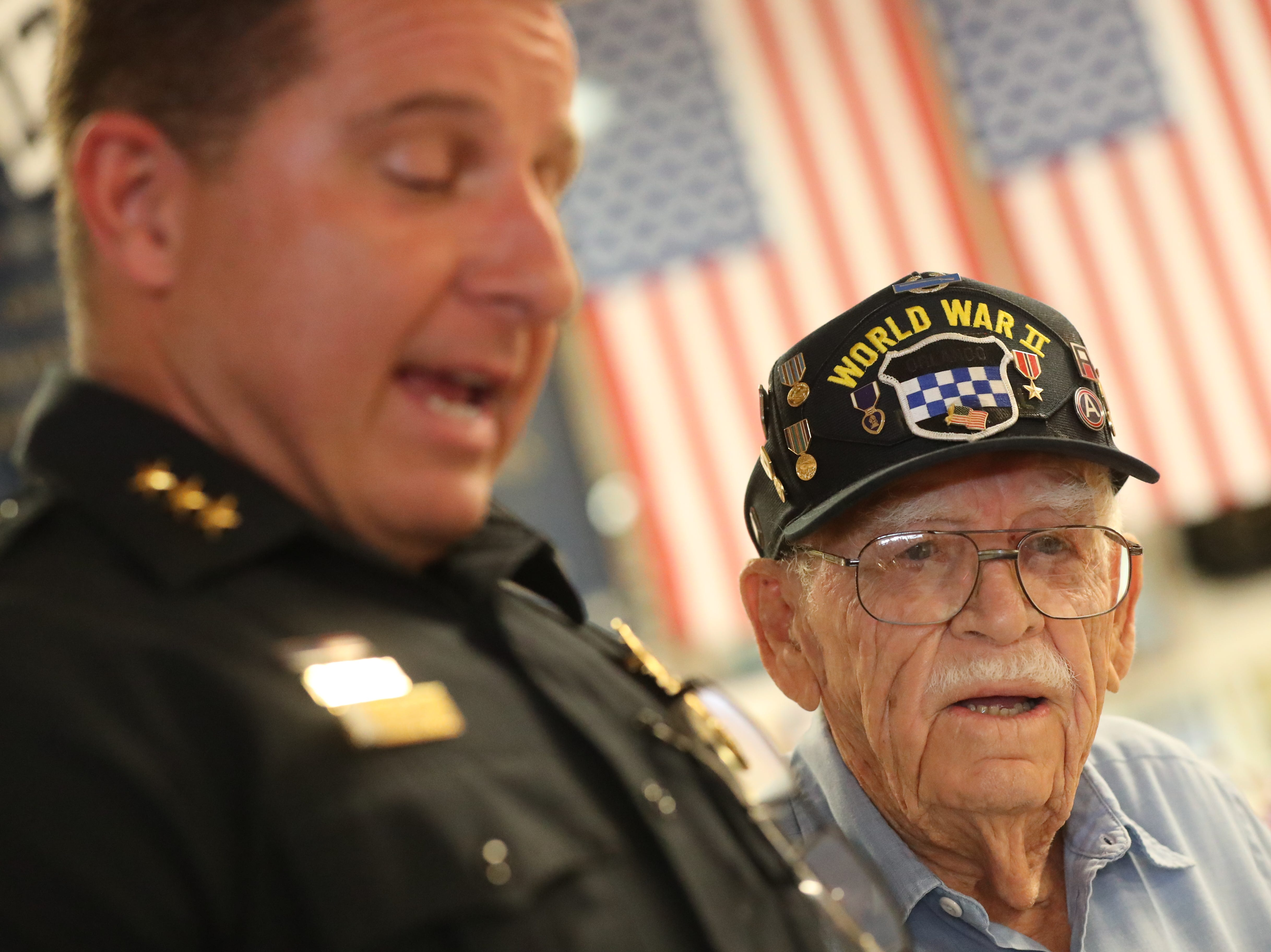 Cape Coral Police Chief David Newlan reads a letter from the Cape Coral Mayor at his party. William Workman turned 97. His family and friends had a surprise birthday party at the Southwest Florida Military Museum, in Cape Coral. Bill was with the 99th Division that landed in Europe on Nov. 17, 1944, then shipped to Bastogne.
