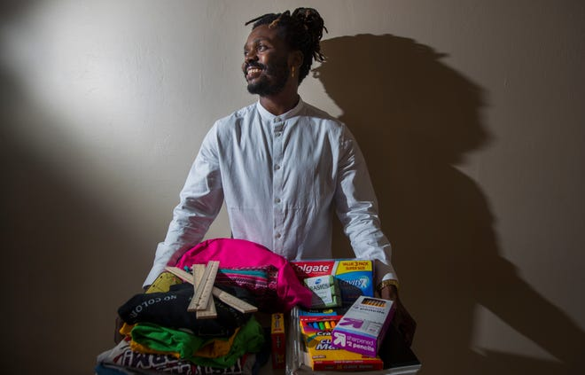 """Fortinel Faustin, 29, a social studies teacher at Golden Gate High School, is one of the creators of the nonprofit organization """"The Faustin Project."""" Fortinel, along with his brother, Jhony, started a charity for children in Mare-Rouge, Haiti, where they grew up. The charity helps send kids to school and provides needed supplies."""